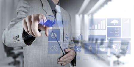 businessman hand working with new modern computer and business strategy as concept Imagens
