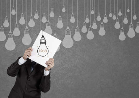 businessman showing the book of drawing idea light bulb concept creative design photo