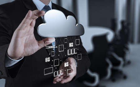 internet cloud: Businessman hand working with a Cloud Computing diagram on the new computer interface as concept