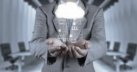 cloud services: Businessman hand working with a Cloud Computing diagram on the new computer interface as concept