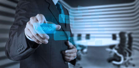 ethic: businessman pointing to leadership skill concept on virtual screen as concept Stock Photo