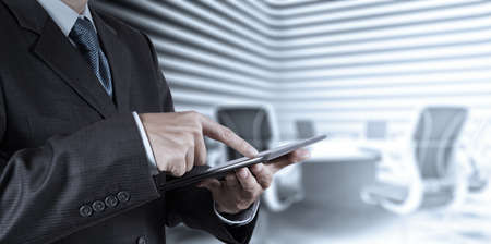 stockholder: businessman success working with tablet computer his board room background