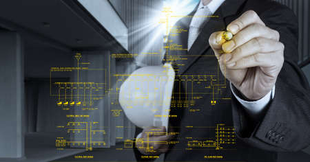 single line: engineer draws an electronic single line and fire alarm riser schematic diagram Stock Photo