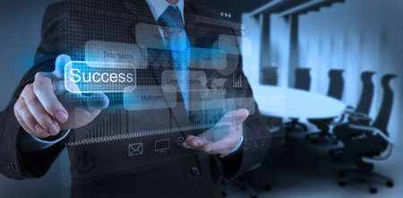 implement: businessman hand draws business success chart concept on virtual screen