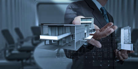 businessman hand presents house model on modern computer as development concept Stock Photo - 20096489