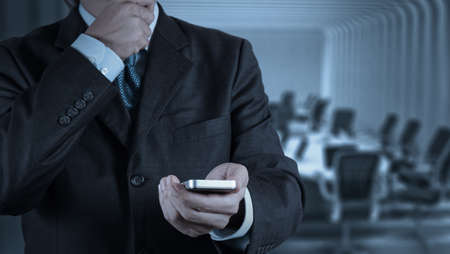sms text: businessman hand use smart phone computer as concept Stock Photo