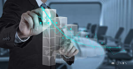 economic growth: businessman hand working with new modern computer and business strategy as concept Stock Photo
