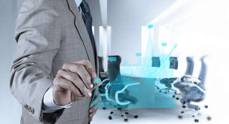 businessman hand working with new modern computer and business strategy as concept photo