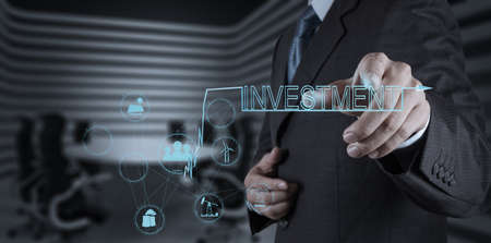 businessman hand pointing to investment as concept Stock Photo - 20101175