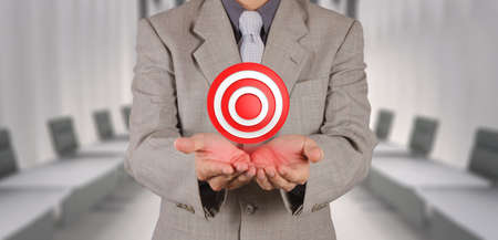 businesses: businessman hand shows target symbol as business concept