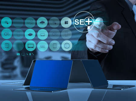 businessman hand showing search engine optimization SEO as concept