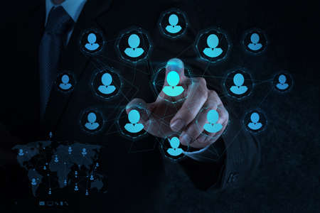 businessman hand points human resources, CRM and social media as concept  photo