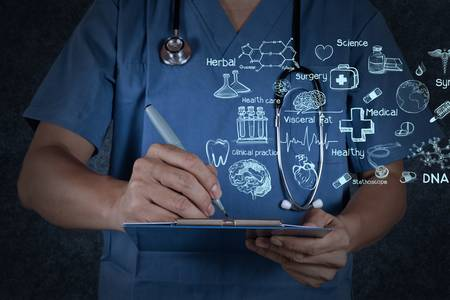 hospital background: medical doctor with stethoscope writing on texture background