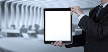 project team: businessman success working with blank tablet computer his board room background