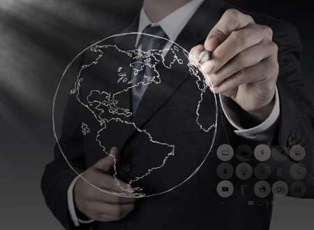 businessman hand drawing abstract globe on virtual screen Stock Photo - 21270814