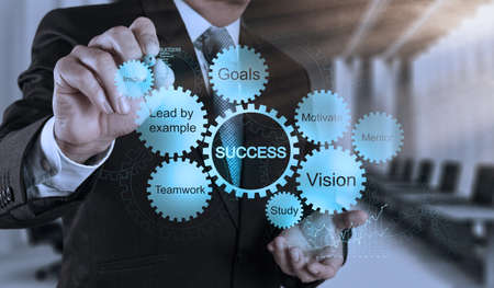 vision business: businessman hand draws business success chart concept on virtual screen