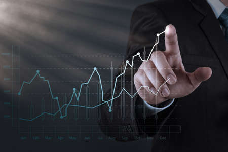 growth chart: businessman hand working with new modern computer and business strategy as concept Stock Photo