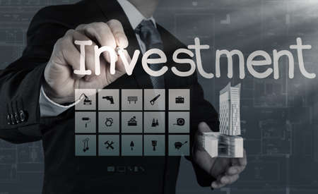 businessman hand pointing to investment concept Stock Photo - 21270868