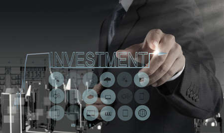 businessman hand pointing to investment concept Stock Photo - 21270869