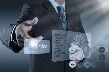 logistic: businessman hand shows logistics diagram as concept