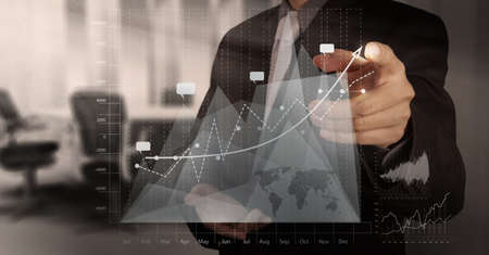 advice: businessman hand working with new modern computer and business strategy as concept Stock Photo