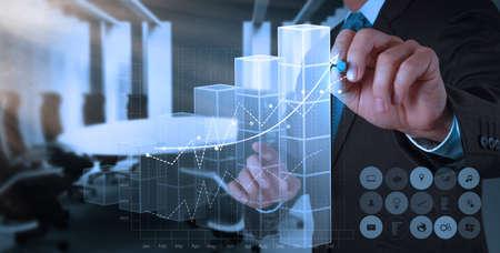 businessman hand draws business success chart concept on virtual screen photo