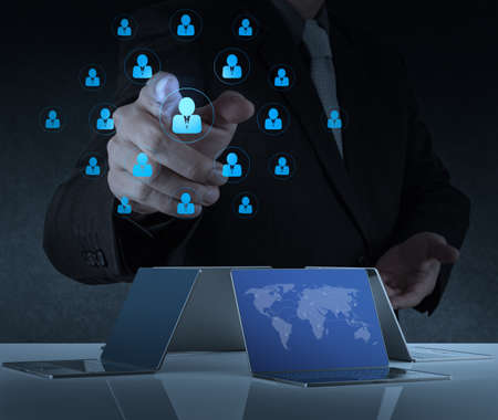 businessman working with new modern computer show social network structure photo