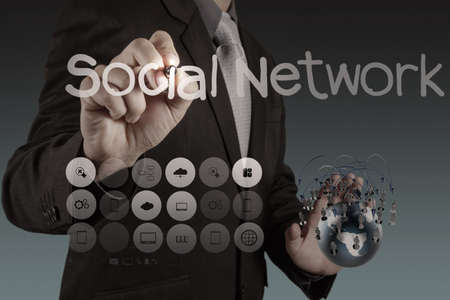 businessman hand holds social network as concept photo