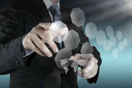businessman shows modern technology as concept Stock Photo - 21270957