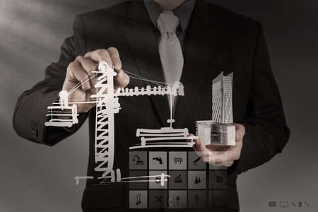 businessman draws building development concept Stock Photo - 21270988
