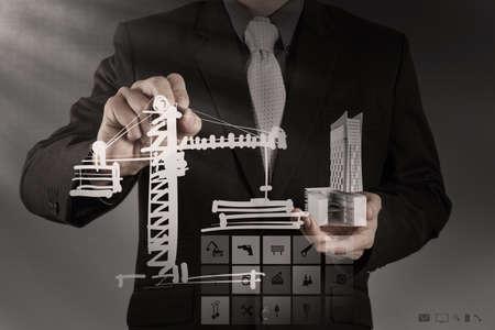 Uomo d'affari disegna lo sviluppo concetto di costruzione Archivio Fotografico - 21270988