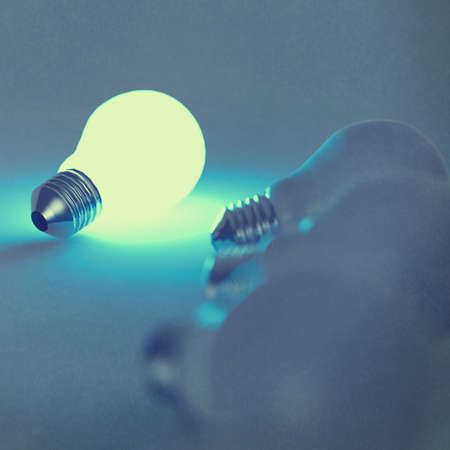 light bulb 3d on blue background photo