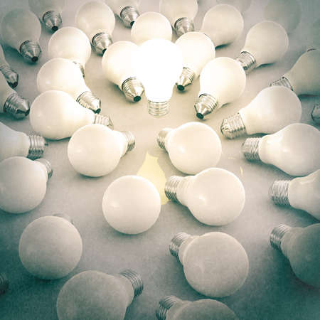 unlit: 3d growing light bulb standing out from the unlit incandescent bulbs as vintage style concept Stock Photo