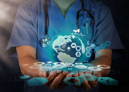 health care professional: Medical Doctor holding a world globe in her hands as medical network concept