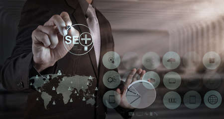 businessman hand showing search engine optimization SEO as concept photo