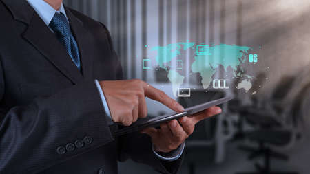 security room: businessman hand using tablet computer and board room background