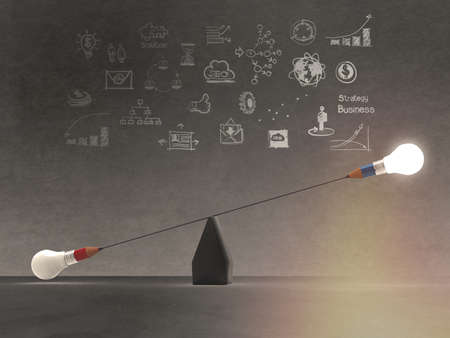 small scale: false balance of pencil lightbulb as concept Stock Photo