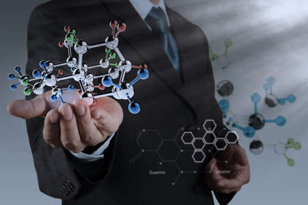 businessman holding a molecule as science concept Stock Photo - 21271289
