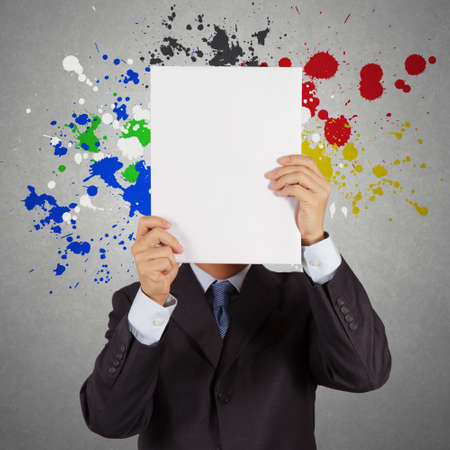 businessman with blank book and splash colors choice as concept photo