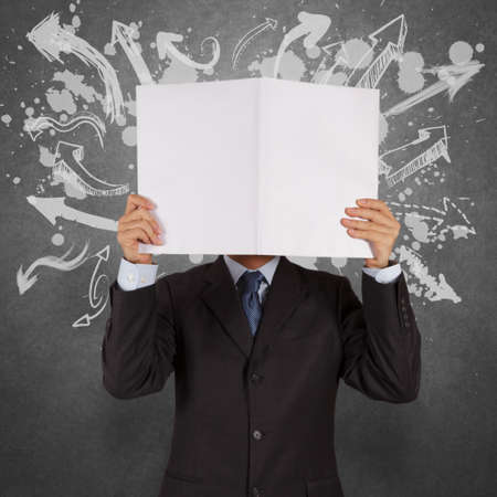 possibility: businessman with blank book and arrows choice as concept Stock Photo