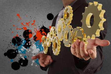 businessman working with gear and splash colors  as concept