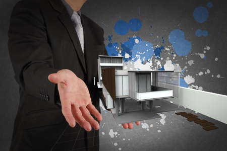 businessman hand shows house model and splash colors as concept Stock Photo - 22006555