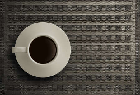3d cup of coffee on mesh steel background photo