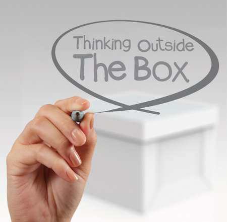 hand draws think outside the box as concept photo