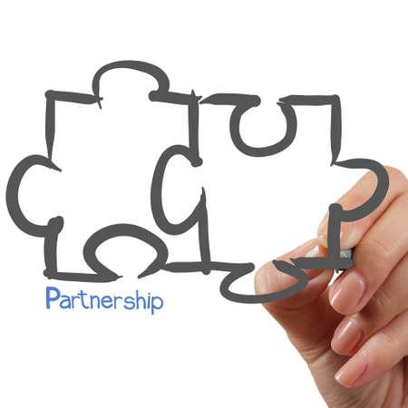 Vrouwelijke Hand tekening partnerschap Puzzle als concept Stockfoto - 22006741