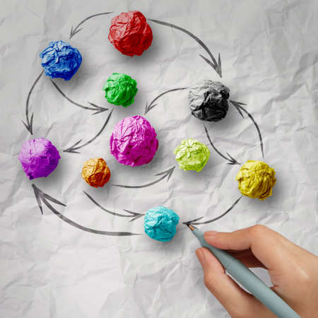 organization structure: hand draws colors crumpled paper as social network structure on wrinkled paper creative concept