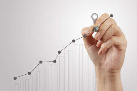financial performance:  hand drawing graph chart and business strategy as concept