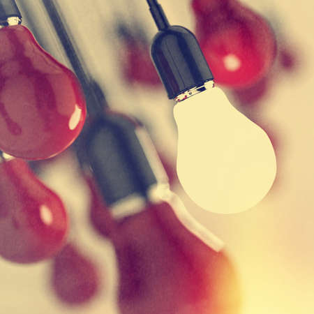 creative idea and leadership concept light bulb as vintage style concept photo