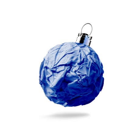 crumpled paper Christmas ornament on white background photo