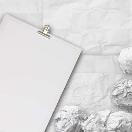 composition of white crumpled paper background texture and blank book photo